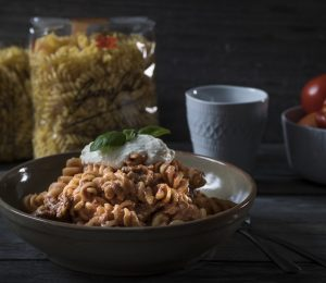 Fusilli pasta topped with ricotta