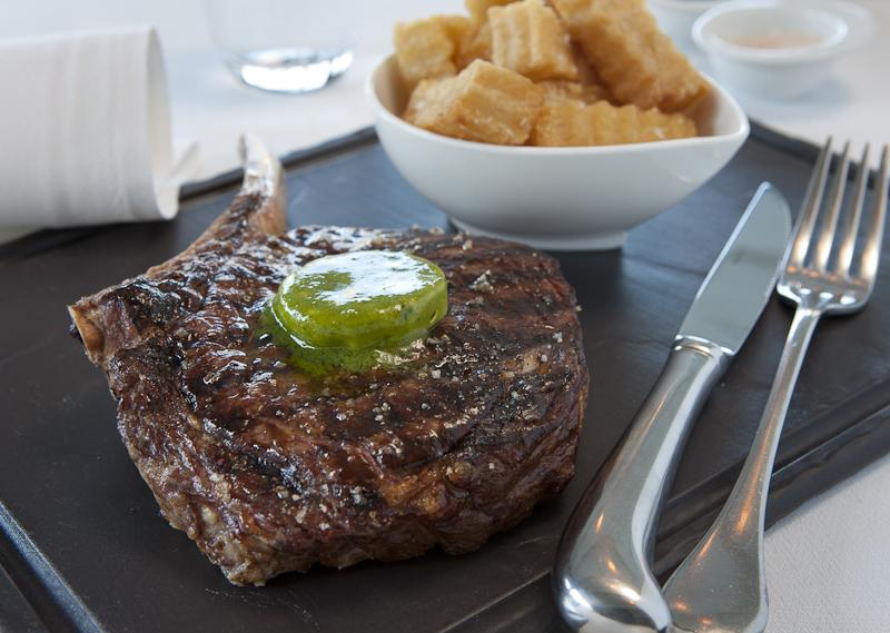 checking steak for doneness